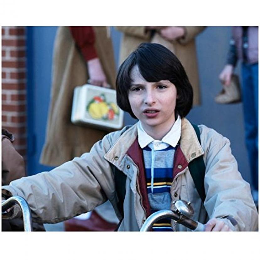 Stranger Things (TV Series 2016 - ) 8 inch x10 inch Photo Finn Wolfhard Looking Confused on Bike kn
